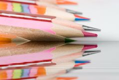 Colors pencils. Shallow DOF red pencil with color ones set diagonal fragment Royalty Free Stock Photography