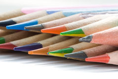 Colors pencils. Shallow DOF red pencil with color ones set diagonal fragment Stock Image