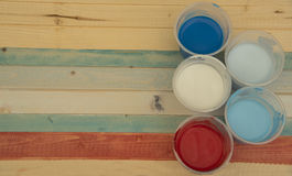 Colors on the plank. Colors on a colored table in half where you can write a message Royalty Free Stock Image
