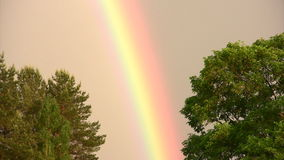Colors of  rainbow. Natural phenomenon of a rainbow after the rain stock video