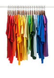 Colors of rainbow, shirts on wooden hangers Stock Photography