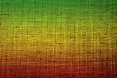 Colors of reggae on the fabric background. Reggae colors on the fabric background. Horizontal orientation royalty free stock photos