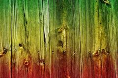 Colors of reggae on the wood background. Reggae colors on the wood background. Horizontal orientation royalty free stock photo
