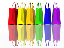 Colors shopping bags. Separated on white - reflection Royalty Free Stock Photography