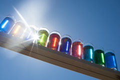 Colors in the Sky - Color Water in shot glasses with the sun shining through Royalty Free Stock Photos