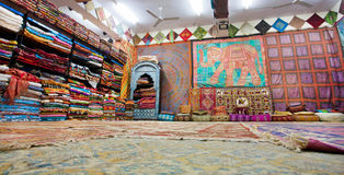 Colors in souvenir shop, carpets and shawls in the old town Stock Image
