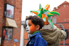 Colors of St. Patrick's Day. LIMERICK, IRELAND - MARCH 17: Unidentified kids with painted faces in Irish colors on the parade od St. Patrick's Day Royalty Free Stock Photography