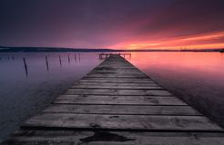 Colors of sunset and the old rusty pier Stock Image