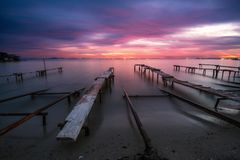 Colors of sunset and the old rusty pier Stock Photo