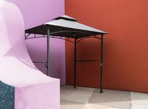 Colors surrounding a canopy. Gazebo in a colorful corner Royalty Free Stock Photo
