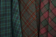 Colors of tartan seamless plaid pattern in fabric store. Royalty Free Stock Photography