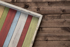 Colors on the tray. The colored tray on the wooden plank Royalty Free Stock Photos