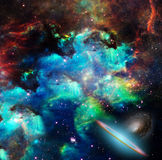 Colors of The Universe. Nebulae, stars, galaxies. Vivid colors.  Some elements provided courtesy of NASA Royalty Free Stock Images