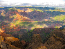 Waimea Canyon. Aerial view of the spectacular and colorful landscape of Waimea Canyon State Park, also called the Grand Canyon of the Pacific, at sunset in Stock Photo