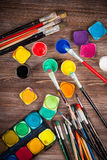 Colors, Watercolors and brushes Stock Images