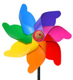 Colors in the wind. Colored plastic and wood wind toy Royalty Free Stock Photography