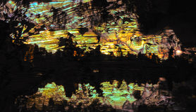 The coloruful stalagmite and stalactite in a tourist cave. Stock Photos