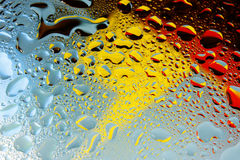 Colorul Abstract background water drops. On glass Royalty Free Stock Image