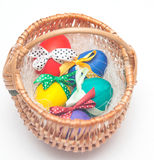 Colorul easter eggs on braiding basket Royalty Free Stock Images
