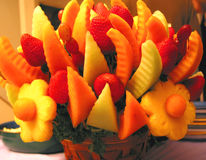 Colorul fruit basket. On a holiday table Royalty Free Stock Photography