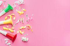 Colorul party streamers on pink background. Celebration concept. Flat lay royalty free stock photos