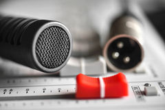 Colose up of a red slide level with hi-fi condenser microphone. Red slide level with hi-fi condenser microphone on close up picture. Focus on microphone grid Stock Photography