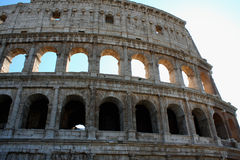 Coloseum against bright blue sky in Rome Italy Royalty Free Stock Photo
