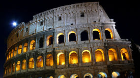 Coloseum at night. Colosseum with night blue moon at Rome Royalty Free Stock Images