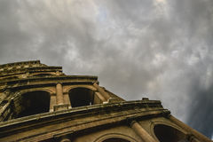 Coloseum under the dark sky. Storm clouds around the colloseum Royalty Free Stock Photo