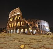 Colossal. View of the Roman Coliseum at night, Rome, Italy Stock Photos