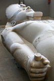 The colossal limestone head and body of Pharaoh Ramesses ll in Egypt. Stock Images