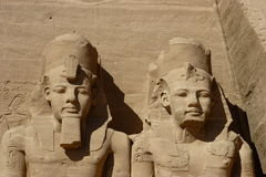 Colossal statues detail at Abu Simbel temple. Detail of two colossus at Abu Simbel. Abu Simbel temples are two massive rock temples in Nubia, southern Egypt  on Royalty Free Stock Photos