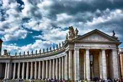 The colossal Tuscan colonnades. VATICAN CITY, VATICAN - MAY 17, 2017: View of the amazing Tuscan colonnades in Saint Peter's square in the Vatican Stock Photography