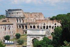 Colosseo ed atc Constantine Immagini Stock