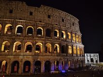 Colosseo Roma night shot. A night shot of the Colosseum in Rome with Costantine arch on the right and side Stock Photos