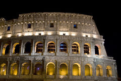 Colosseum. Antique colosseum at night in Rome with lights Stock Photos