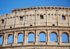 Colosseum against a blue sky. Part of the Colosseum against a blue sky Rome, Italy Stock Photo