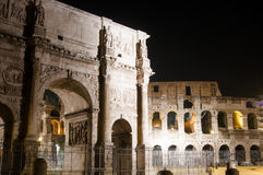 Colosseum and Arch of Constantine at night Royalty Free Stock Image