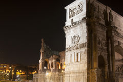 Colosseum and Arch of Constantine at night Royalty Free Stock Photography