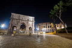 Colosseum and Arch of Constantine in Rome, Italy. Colosseum and Arch of Constantine in Rome in the Night, Italy Royalty Free Stock Images