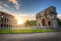 Colosseum and Arch of Constantine, Rome, Italy. Colosseum and Arch of Constantine at Sunrise with Blue Sky, Rome, Italy Royalty Free Stock Photos