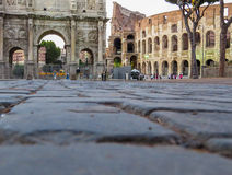 The Colosseum and the Arch of Constantine in Rome, Italy Royalty Free Stock Images