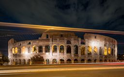 Colosseum and Light Streaks in Night stock photos