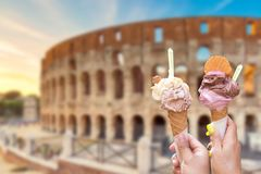 Free Colosseum At Sunset In Rome, Italy With Italian Ice Cream Gelato In Hands. World Famous Landmark In Italy Royalty Free Stock Photo - 165589755