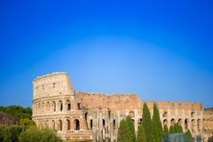 Colosseum or Coliseum background blue sky in Rome, Italy. Colosseum background blue sky in Rome, Italy Stock Photo