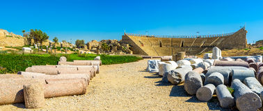 The colosseum of Caesarea. The ancient Roman Colosseum with the lying ruined columns on the foreground, Caesarea, Israel Royalty Free Stock Photography