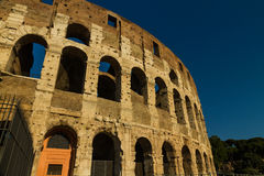 Colosseum or Coliseum Amphitheatre, evening in Rome. Royalty Free Stock Images
