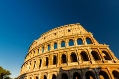 Colosseum or Coliseum Amphitheatre, evening in Rome. Royalty Free Stock Image