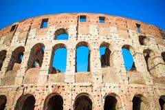 Colosseum or Coliseum background blue sky in Rome. Italy Royalty Free Stock Photography