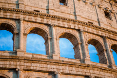 Colosseum or Coliseum background blue sky in Rome, Italy. Colosseum background blue sky in Rome, Italy Royalty Free Stock Photo